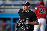 Umpire Jacob Dallas gets in position to make a call during a game between the Batavia Muckdogs and State College Spikes at Dwyer Stadium on June 25, 2012 in Batavia, New York.  State College defeated Batavia 7-4.  (Mike Janes/Four Seam Images)