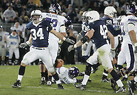 State College, PA - 11/06/2010:  LB Nate Stupar (34) and Michael Mauti (42) celebrate tackling QB Dan Persa for a loss during the fourth quarter.  Despite trailing 21-0 in the first quarter, Penn State defeated Northwestern by a score of 35-21 at Beaver Stadium to give head coach Joe Paterno his 400th career victory...Photo:  Joe Rokita / JoeRokita.com..Photo ©2010 Joe Rokita Photography