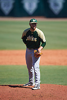 USF Bulls pitcher Andres Perez (26) looks in for the sign during live batting practice on February 11, 2017 at USF Baseball Stadium in Tampa, Florida.  (Mike Janes/Four Seam Images)