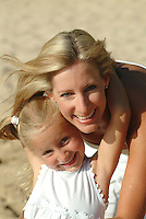 Portrait of a mother and young daughter on the beach while on vacation in Hawaii