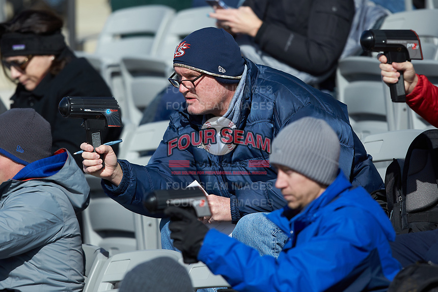 New York Yankees scout Mike Gibbons uses a radar gun during the NCAA baseball game between the Bellarmine Knights and the North Greenville Crusaders at Ashmore Park on February 7, 2020 in Tigerville, South Carolina. The Crusaders defeated the Knights 10-2. (Brian Westerholt/Four Seam Images)
