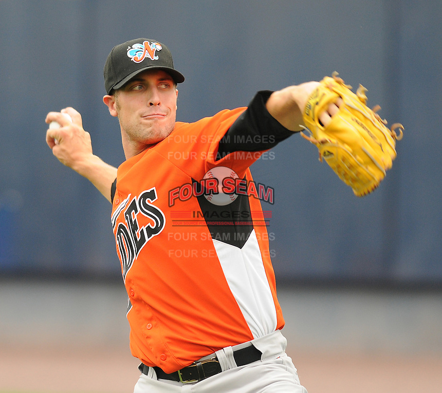 Starting pitcher Mitch Atkins (24) of the Norfolk Tides, International League affiliate of the Baltimore Orioles, prior to a game against the Scranton/Wilkes-Barre Yankees on June 20, 2011, at PNC Park in Moosic, Pennsylvania. (Tom Priddy/Four Seam Images).