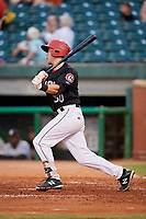 Chattanooga Lookouts catcher Brian Olson (30) hits a single during a game against the Jackson Generals on May 9, 2018 at AT&T Field in Chattanooga, Tennessee.  Chattanooga defeated Jackson 4-2.  (Mike Janes/Four Seam Images)