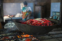 Bali, Indonesia.  Red Peppers, Onions, and Rice Warming near a Charcoal Fire, Jimbaran Fish Market.