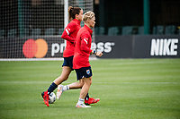 TACOMA, WA - JULY 31: Jessica Fishlock #10 and Lauren Barnes #3 of the OL Reign warm up together before a game between Racing Louisville FC and OL Reign at Cheney Stadium on July 31, 2021 in Tacoma, Washington.
