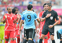 July 26, 2012..Match referee speaks to Uruguay's Luis Suarez after a foul whistle during UAE vs Uruguay Football match during 2012 Olympic Games at Old Trafford in Manchester, England. Uruguay defeat United Arab Emirates 2-1...
