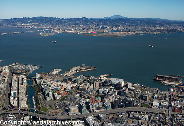 aerial photograph of Mission Bay, San Francisco, California to downtown Oakland and the Mount Diablo