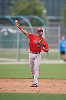Boston Red Sox Yeison Coca (11) throws to first base during a minor league Spring Training game against the Canada Junior National Team on March 31, 2017 at JetBlue Park in Fort Myers, Florida. (Mike Janes/Four Seam Images)