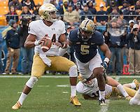 Pitt defensive end Ejuan Price (5) sacks Notre Dame quarterback DeShone Kizer. The Notre Dame Fighting Irish football team defeated the Pitt Panthers 42-30 on Saturday, November 7, 2015 at Heinz Field, Pittsburgh, Pennsylvania.