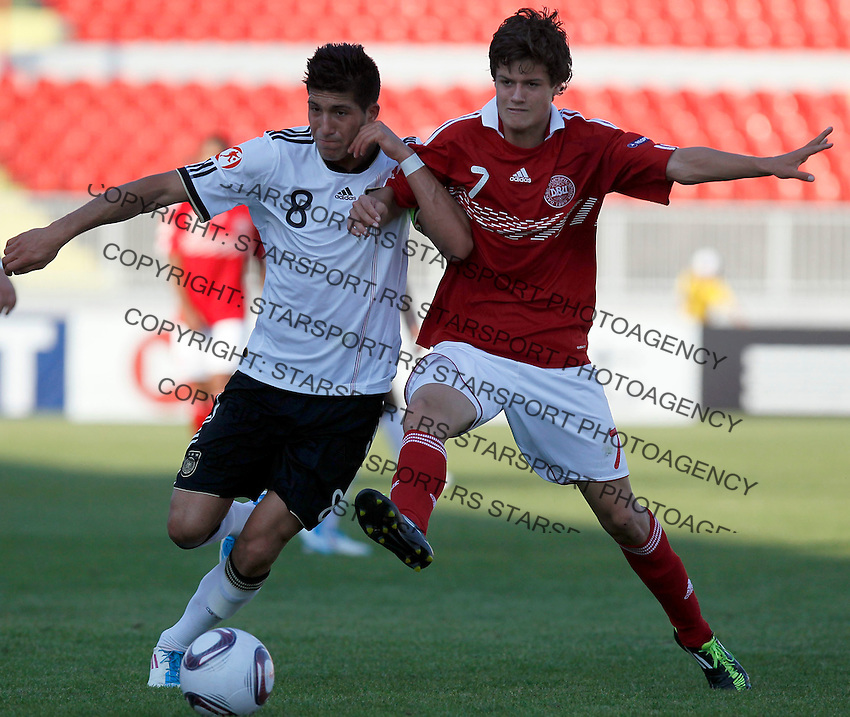 Emre Can (L) of Germany compete for the ball with Denmark player Christian Norgaard of Denmark during the UEFA U-17 championships Semi Final match between Denmark and Germany on May 12, 2011 in Novi Sad, Serbia. (Photo by Srdjan Stevanovic/Starsportphoto.com)