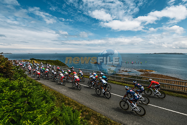 The peloton ride along the coastline during Stage 2 of the 2021 Tour de France, running 183.5km from Perros-Guirec to Mur-de-Bretagne Guerledan, France. 27th June 2021.  <br /> Picture: A.S.O./Charly Lopez | Cyclefile<br /> <br /> All photos usage must carry mandatory copyright credit (© Cyclefile | A.S.O./Charly Lopez)