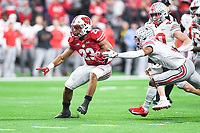 Indianapolis, IN - DEC 7, 2019: Wisconsin Badgers running back Jonathan Taylor (23) makes Ohio State Buckeyes defenders miss on his way to a 44 yard touchdown run during Big Ten Championship game between Wisconsin and Ohio State at Lucas Oil Stadium in Indianapolis, IN. Ohio State came back from a 21-7 deficit at halftime to beat Wisconsin 34-21 to win its third straight Big Ten Championship. (Photo by Phillip Peters/Media Images International)