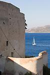Sailboat enters Calvi harbor, Calvi, Northwest coast of Corsica, France, Mediterranean Coast, Coastal towns in Corsica,