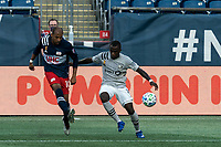 FOXBOROUGH, MA - SEPTEMBER 23: Teal Bunbury #10 of New England Revolution passes the ball as Zachary Brault-Guillard #15 of Montreal Impact defends during a game between Montreal Impact and New England Revolution at Gillette Stadium on September 23, 2020 in Foxborough, Massachusetts.