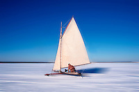 Iceboating in antique Penguin boat