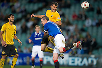 SYDNEY, AUSTRALIA - JULY 31, 2010: David Weir of Rangers fights for the ball during the match between AEK Athens FC and Glasgow Rangers at the 2010 Sydney Festival of Football held at the Sydney Football Stadium on July 31, 2010 in Sydney, Australia. (Photo by Sydney Low / www.syd-low.com)