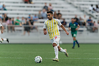 HARTFORD, CT - AUGUST 17: Stavros Zarokostas #9 of Charleston Battery brings the ball forward during a game between Charleston Battery and Hartford Athletic at Dillon Stadium on August 17, 2021 in Hartford, Connecticut.