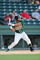 Shortstop Justin Twine (1) of the Greensboro Grasshoppers bats in a game against the Greenville Drive on Wednesday, August 26, 2015, at Fluor Field at the West End in Greenville, South Carolina. Greenville won, 7-0.  (Tom Priddy/Four Seam Images)