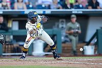 Michigan Wolverines second baseman Ako Thomas (4) squares to bunt against the Vanderbilt Commodores during Game 1 of the NCAA College World Series Finals on June 24, 2019 at TD Ameritrade Park in Omaha, Nebraska. Michigan defeated Vanderbilt 7-4. (Andrew Woolley/Four Seam Images)