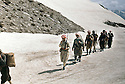 Iraq 1963 .Peshmergas walking in the snow near the Iranian border.Itak 1963.Peshmergas marchant dans la neige pres de la frontiere iranienne