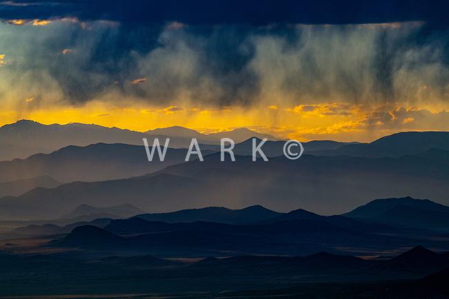 Virga and layered mountain ranges at sunset, near Canon City, Colorado