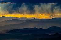 Virga and layered mountain ranges at sunset, near Canon City, Colorado