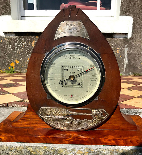 Flica's barometer, set in a section of her broken mast salvaged after it came down on August 15th 1957 at the Cobh People's Regatta.