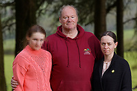 LEGAL NOTICE: THERE IS NOW A COURT ORDER PREVENTING THE IDENTIFICATION OF DANIELLE JOHN AND ANY PUBLICATION OF HER PICTURES Pictured: Byron John, Bradley's father with partner Kate Pickerd and daughter Danielle (DANIELLE JOHN CANNOT BE IDENTIFIED AND/OR NAMED).<br /> Re: A verdict for a Coroner's inquest into the death of 14 year old Bradley John, who was found dead by his sister at his school, will be read out at the Coroner's Court in Llanelli, Wales, UK.<br /> Talented young horse rider Bradley John, 14, was found hanged in the school toilets by his younger sister Danielle (DANIELLE JOHN CANNOT BE IDENTIFIED AND/OR NAMED) at the 500-pupils St John Lloyd Roman Catholic school in Llanelli, South Wales in September 2018.<br /> Bradley's family claim he had been bullied for two years after being diagnosed with Attention Deficit Hyperactivity Disorder.<br /> He went missing during lessons and was found in the toilet cubicle by his sister Danielle (DANIELLE JOHN CANNOT BE IDENTIFIED AND/OR NAMED), who was 12 at the time.