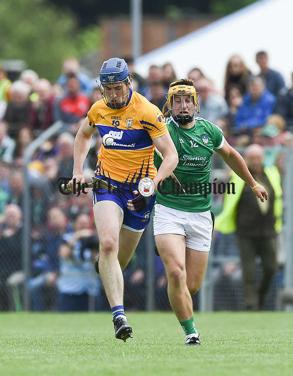 David Fitzgerald of Clare in action against Tom Morrissey of Limerick during their Munster championship game in Ennis. Photograph by John Kelly.