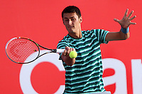 BOGOTA -COLOMBIA , 16 -JULIO-2014. Bernard Tomic de Australia en  accion  contra Alejandro Falla  de Colombia durante el Torneo ATP 250  Claro Open Colombia 2014  disputado en el Centro de alto Rendimiento de la capital . /  Bernard Tomic of Australia in action against Alenadro Falla of  Colombia during the ATP  250 Claro Open Colombia 2014 match  played at the Centro de Alto Rendimiento  in the capital. Photo: VizzorImage / Felipe Caicedo / Staff