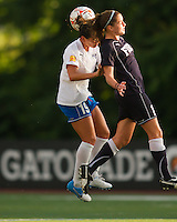 Boston Breakers defender Bianca D'Agostino (19) and New York Fury midfielder Sinead Farrelly (17) compete for a head ball.  The Boston Breakers beat the New York Fury 2-0 at Dilboy Stadium