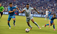 KANSAS CITY, KS - MAY 29: Joe Corona #14 of Houston Dynamo FC and Khiry Shelton #11 of Sporting KC fight it out near the touch line during a game between Houston Dynamo and Sporting Kansas City at Children's Mercy Park on May 29, 2021 in Kansas City, Kansas.