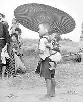 While big brother's attention is riveted on some object up the road on Okinawa, the little fellow protests against the delay, for all he wants is to get home.  1945. T. Sgt. Glen A. Fitzgerald.  (Marine Corps)<br /> Exact Date Shot Unknown<br /> NARA FILE #:  127-GR-99-122422<br /> WAR & CONFLICT BOOK #:  1269