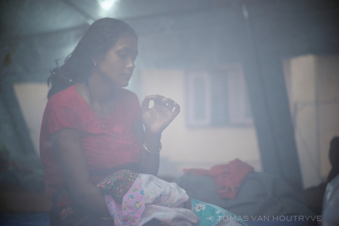 Amrita Uperkoti holds her four-day-old baby inside a temporary tent at the hospital at the Gorkha District Hospital in Gorkha Bazaar, Nepal in June 2015.