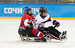 Sochi, RUSSIA - Mar 11 2014 -  Derek Whitson gets tied up by a Czech player as Canada takes on Czech Republic in Sledge Hockey at the 2014 Paralympic Winter Games in Sochi, Russia.  (Photo: Matthew Murnaghan/Canadian Paralympic Committee)