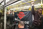 "© Joel Goodman - 07973 332324 . 28/03/2015 . Manchester , UK . Neo-Nazis on a Metrolink tram alongside commuters at Piccadilly in Manchester . Approximately 100 neo-Nazis gather in Manchester for "" White Pride Worldwide day "" . Photo credit : Joel Goodman"