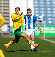 12th September 2020 The John Smiths Stadium, Huddersfield, Yorkshire, England; English Championship Football, Huddersfield Town versus Norwich City;  Todd Cantwell of Norwich City challenges  Harry Toffolo of Huddersfield Town for the ball