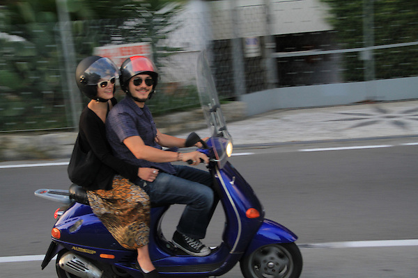 Man and woman on motor scooter in Bogliasco, Genova, Italy. .  John offers private photo tours in Denver, Boulder and throughout Colorado, USA.  Year-round. .  John offers private photo tours in Denver, Boulder and throughout Colorado. Year-round.
