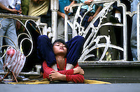 A young migrant gymnast entertains a crowd in Haizhu Park, Guangzhou. This type of performance has been a tradition in China for centuries.