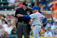 New York Mets manager Terry Collins #10 talks with home plate umpire Jerry Layne in between innings during a Spring Training game against the Detroit Tigers at Joker Marchant Stadium on March 11, 2013 in Lakeland, Florida.  New York defeated Detroit 11-0.  (Mike Janes/Four Seam Images)
