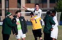 Jay Chapman (10) of Michigan State celebrates with teammate Zach Bennett (1) after the third round of the NCAA tournament at Shaw Field in Washington, DC. Michigan State defeated Georgetown, 1-0.