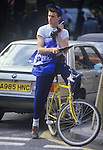 Bike courier with large brick mobile phone 1980s. London Uk