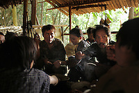 Van Chang, right, a veteran of the CIA Secret War eats boiled roots with his family in a temportary hidden village in the Vientiane province of Laos on 28 November 2007. Thousands of Hmongs who fought or collaborated with the American CIA until communists took over the country in 1975 remain hidden in the jungles of Laos and are regular targets of the Lao People's Army