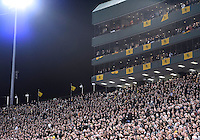 Section of stadium during the singing of National Anthem before NCAA football game kickoff at Floyd Casey Stadium in Waco, TX.before NCAA football game kickoff at Floyd Casey Stadium in Waco, TX.