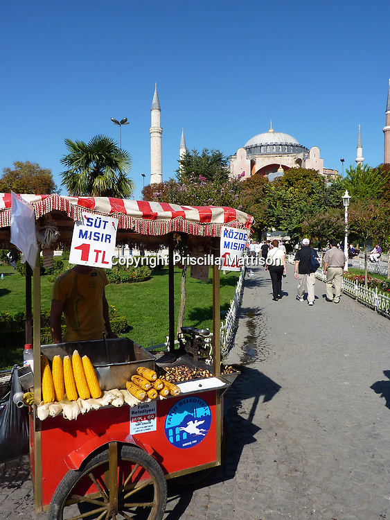 Istanbul, Turkey - September 24, 2009:  A corn-on-the cob cart is parked in front of the Hagia Sophia.