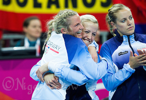 11 AUG 2012 - LONDON, GBR - Ida Alstad (NOR) (left) and Heidi Løke (NOR) (centre) of Norway celebrate winning the women's London 2012 Olympic Games handball final against Montenegro at the Basketball Arena in the Olympic Park, in Stratford, London, Great Britain (PHOTO (C) 2012 NIGEL FARROW)