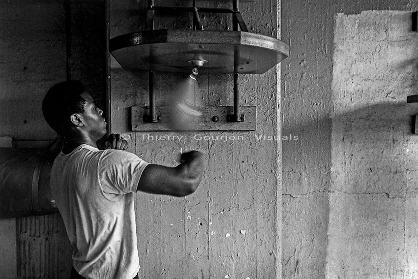 A boxer at the speed bag at Gleason's Gym, Brooklyn, New York.<br />Photograph by Thierry Gourjon-Bieltvedt. 1995-2005