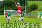 Daniel Griffin Glenbeigh/Glencar makes a spectacular catch over Stephen Roche Milltown/Castlemaine  during their IFC clash in Killorglin on Sunday