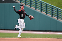Rochester Red Wings second baseman James Beresford (2) throws to first during a game against the Louisville Bats on May 4, 2014 at Frontier Field in Rochester, New  York.  Rochester defeated Louisville 12-6.  (Mike Janes/Four Seam Images)