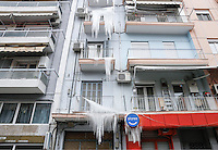 Pictured: Water has frozen on balconies of a block of flats in central Salonika, Greece. Monday 09 January 2017<br />
